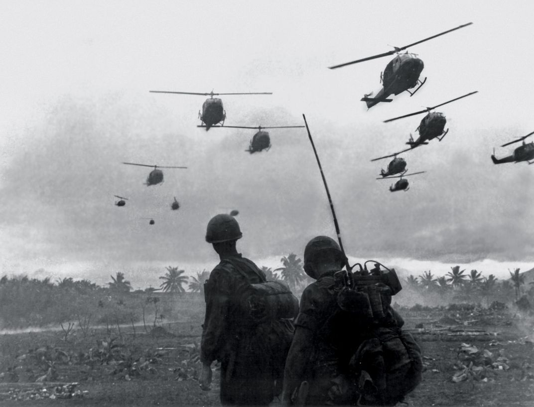 Two Army Soldiers Watch A Wave Of Bell Uh 1 Iroquois Helicopters During The Vietnam War Ca 1967 The Vietnam Helicopter Pilots Association Estimates That