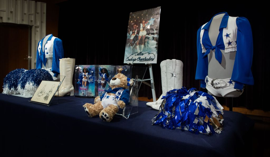 Among the donated items were two complete uniforms—one modern, one vintage—and an official 1977 DCC poster.