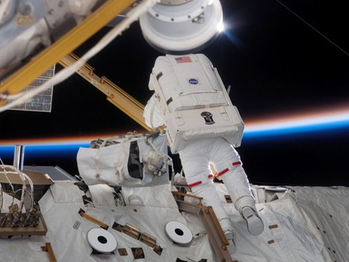 Spacewalking astronauts add solar arrays to the space station.