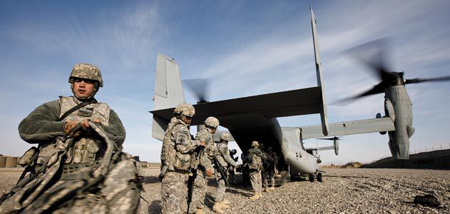 The Osprey's role in Afghanistan has been mainly assault support: transporting troops and supplies (here, Army soldiers unload gear from an MV-22 at a remote combat outpost).