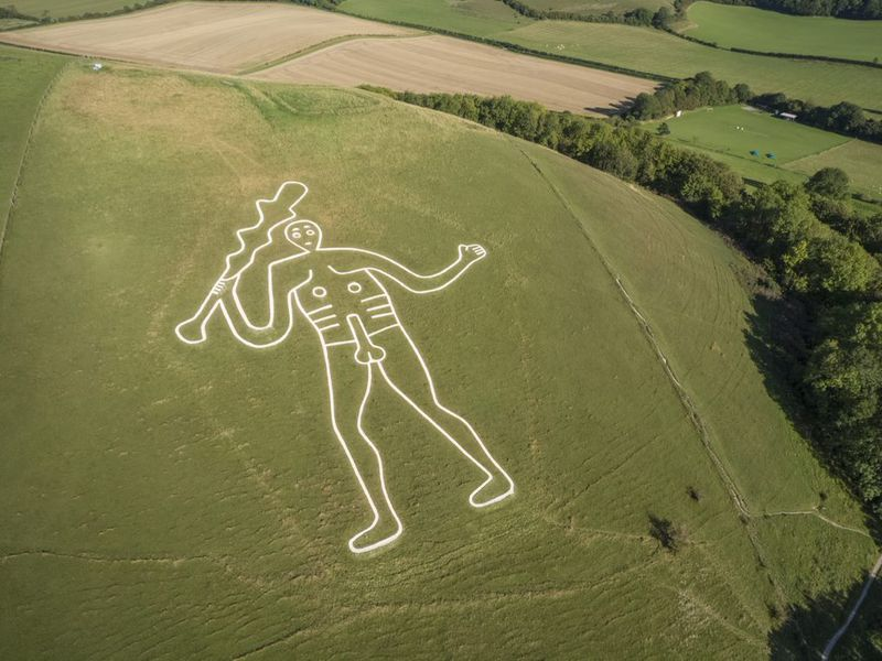 Aerial view of the Cerne Abbas Giant, a 180-foot chalk drawing of a well-endowed man