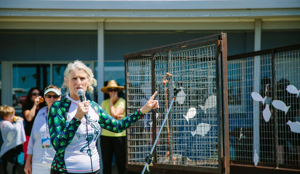 Organizer Nisa Schebella addresses a crowd gathered in Victor Harbor to protest Oceanic Victor, a swim-with-tuna attraction.