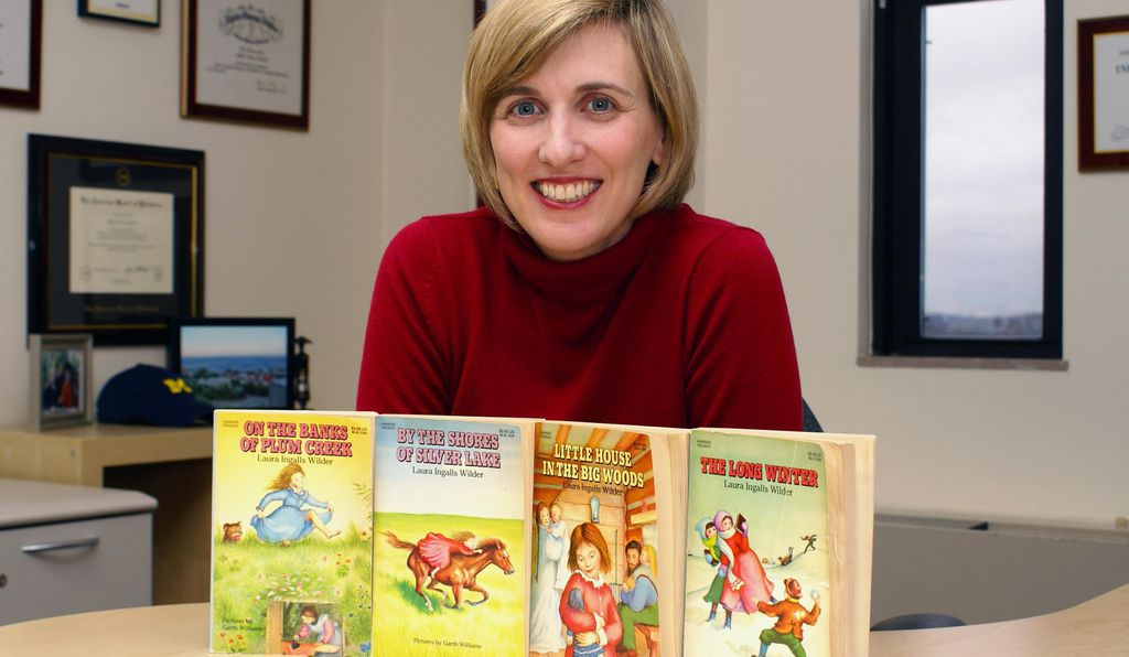 Beth Tarini, an assistant professor of pediatrics at the University of Michigan, with her collection of Wilder books.