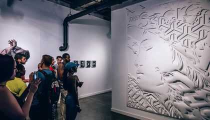 Visitors look at a large, cut-paper work by Ian Kuali'i (Native Hawaiian and Mescalero Apache), on view at the Red Bull House of Art Detroit. Kuali'i was a resident artist at the experimental, noncommercial arts organization in 2016. (Red Bull, courtesy of Ian Kuali'i)