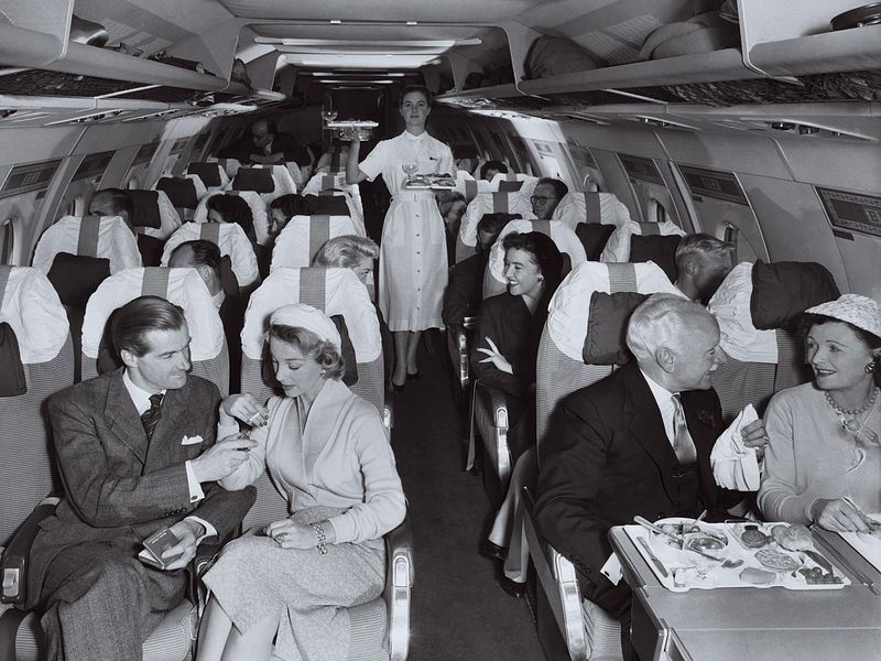 passengers onboard a plane in the 1950s