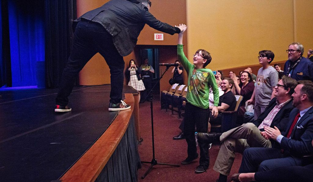 Joe Russo high-fives an astute young fan during the Q&A portion of the recent event.