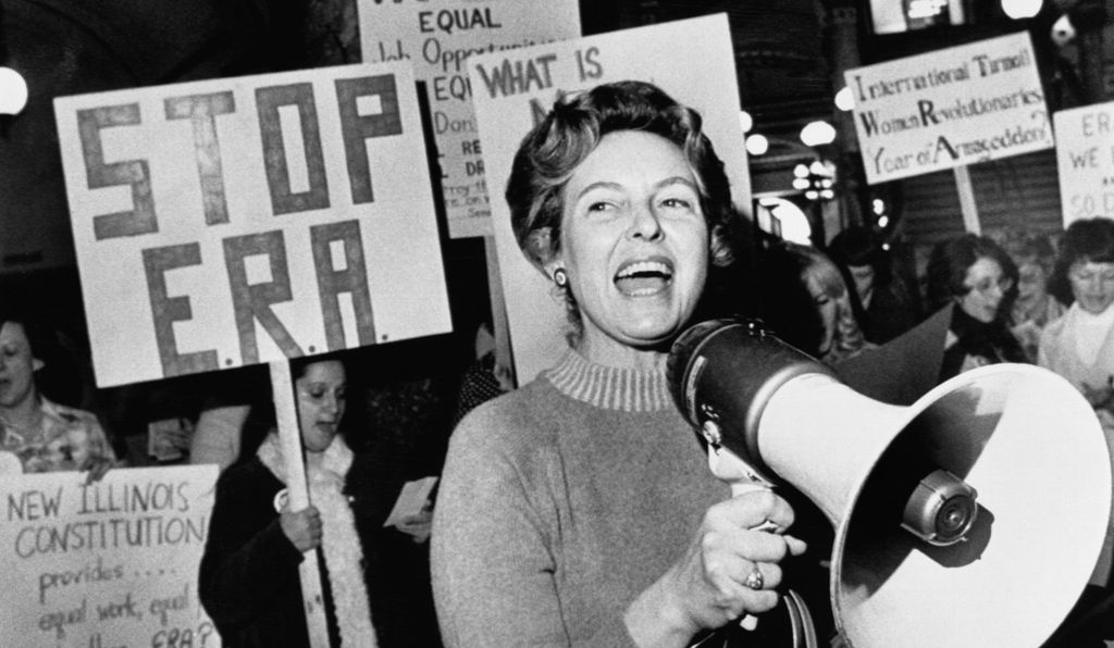 Phyllis Schlafly leads members opposed to the equal rights amendment in a song about the pro ERA forces plan for a national demonstration in the capitol city.
