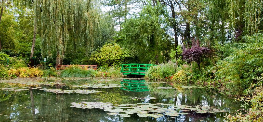 The famous lily pads and green bridge at Giverny used as inspiration for Monet (2018 departures)