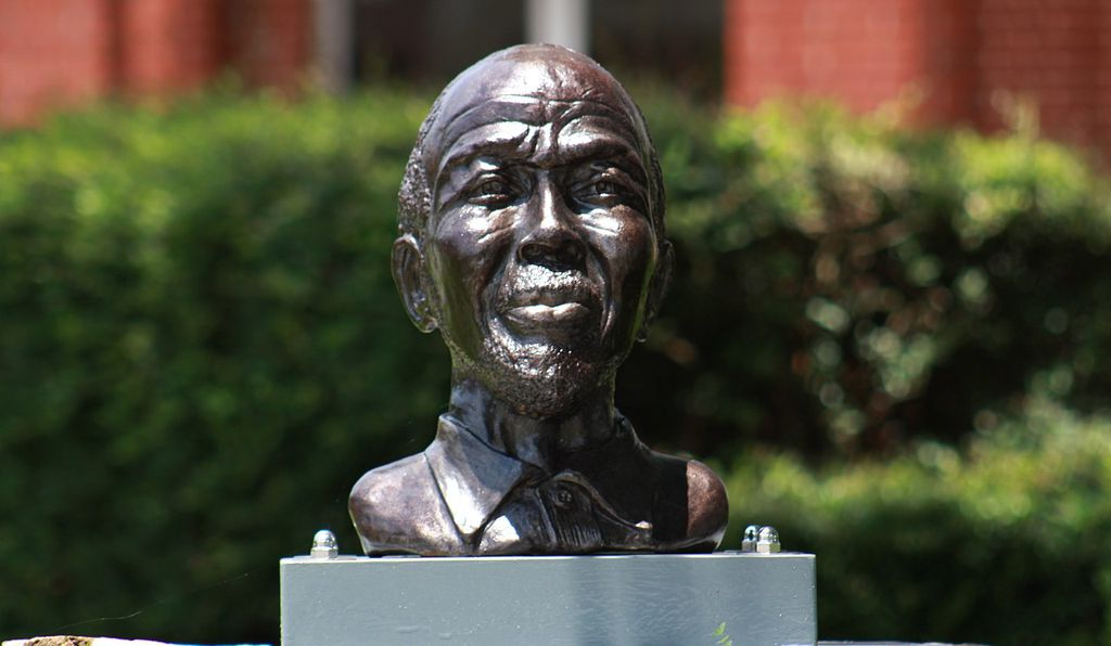 A cast iron bust of Cudjo Lewis, one of the last survivors of the slave ship <em>Clotilde,</em> can be found in front of the historic Union Missionary Baptist Church in Africatown.