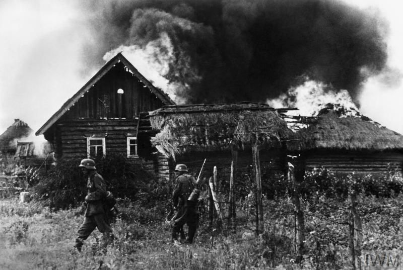 German troops occupy a burning Russian village in summer 1941
