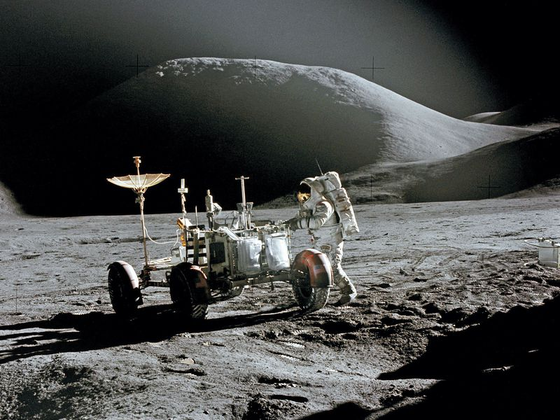 Jim Irwin and rover on moon
