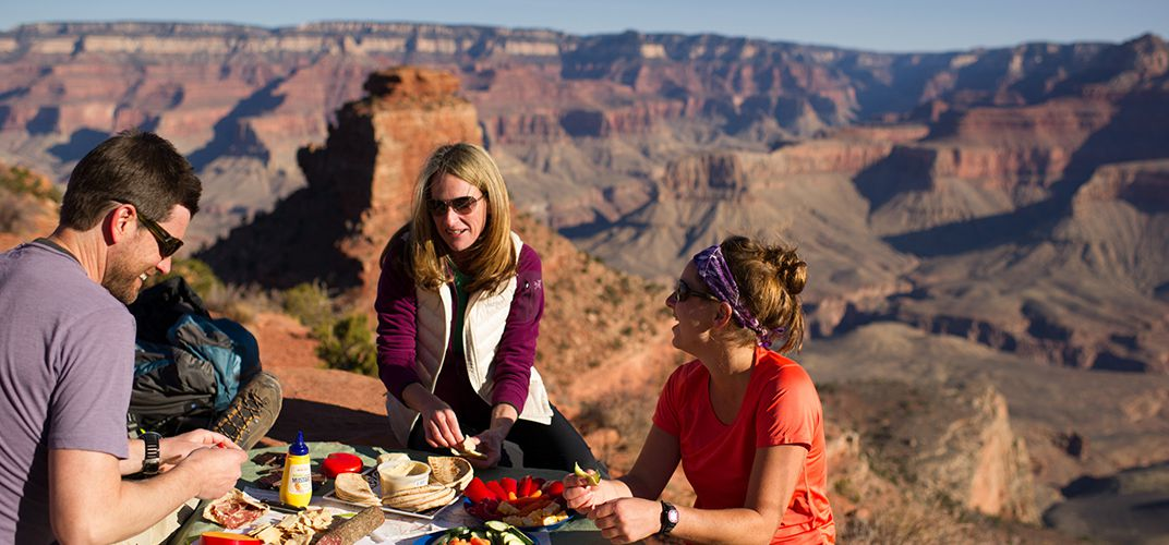Hikers enjoy a meal overlooking the Grand Canyon