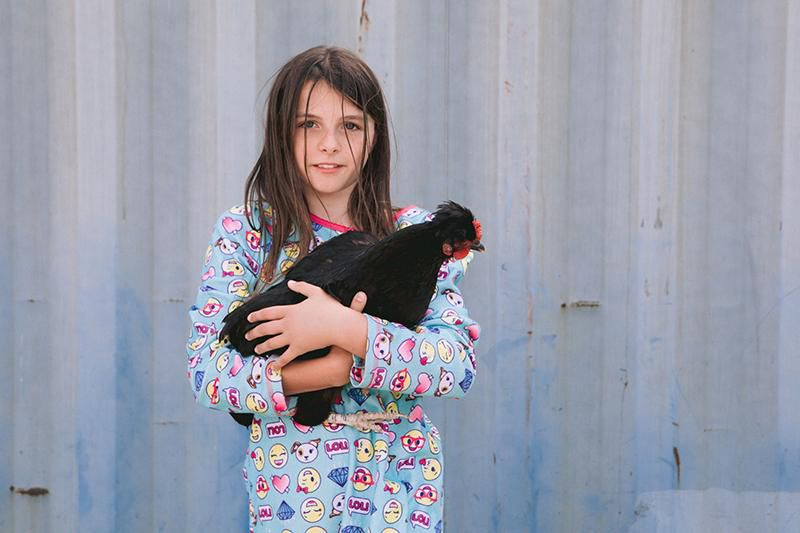 Girl with chicken Yvette Roman Photography.jpg