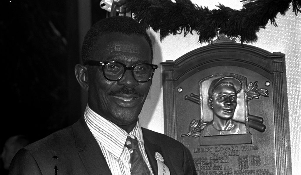 Satchel Paige poses with his Baseball Hall of Fame plaque on his induction day, August 9, 1971, at Cooperstown, New York. Paige was the third black player inducted to the Hall, and the first inducted for Negro League achievements.