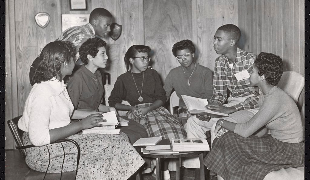 Seven of the Little Rock Nine, including Melba Pattillo Beals, Carlotta Walls LaNier, Jefferson Thomas, Elizabeth Eckford, Thelma Mothershed-Wair, Terrence Roberts and Gloria Ray Karlmark, meet at the home of Daisy Bates.