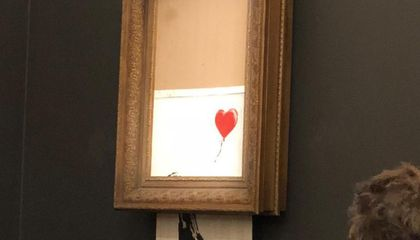 Watch This $1.4 Million Bansky Painting Shred Itself As Soon As It's Sold