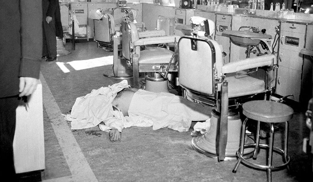 The body of Albert Anastasia - who ran Murder, Inc., a gang of hired killers for organized crime, in the late 1930s - lies on the barbershop floor at the Park Sheraton Hotel, Seventh Avenue and West 55th Street, soon after his murder by two gunmen at 10:20 A.M.