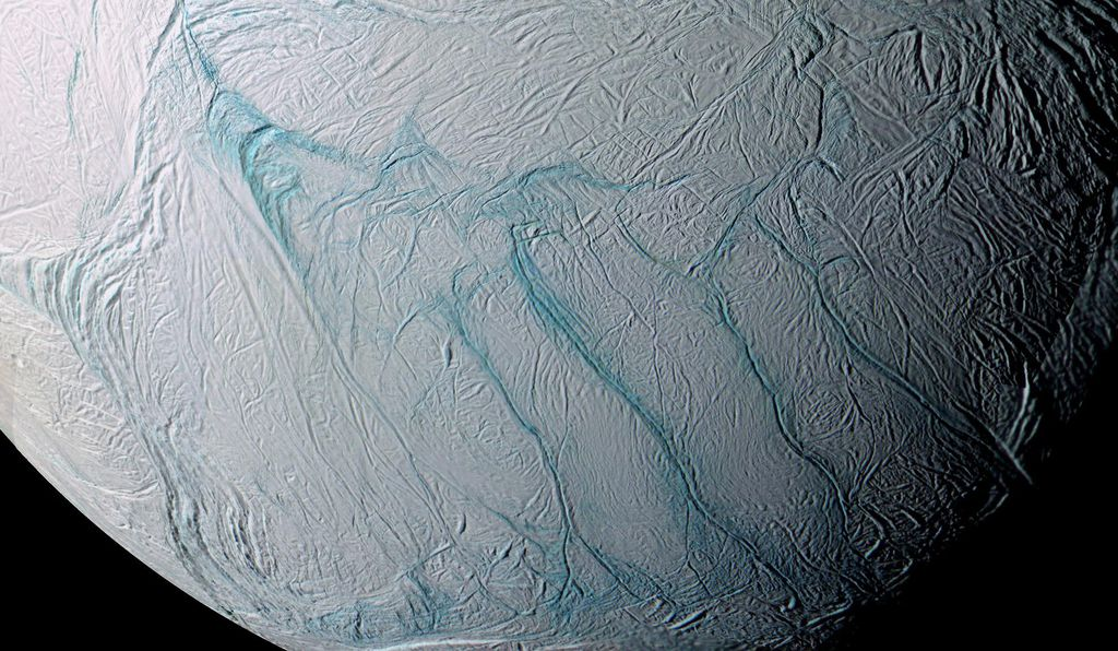 Tidal forces crack the icy crust of Saturn's moon Enceladus. The ocean below rushes up to the surface and freezes, creating its stripes.