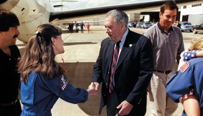 George Abbey rode with the astronauts to the launch pad before every shuttle launch, and was there to greet them when they returned (here with STS-93's Cady Coleman).