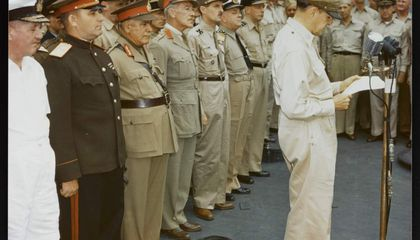General Douglas MacArthur making remarks at the surrender ceremony aboard the USS Missouri. Behind him are representatives of the major Allied powers. U.S. National Archives, Army Signal Corps Collection, USA C-2716.