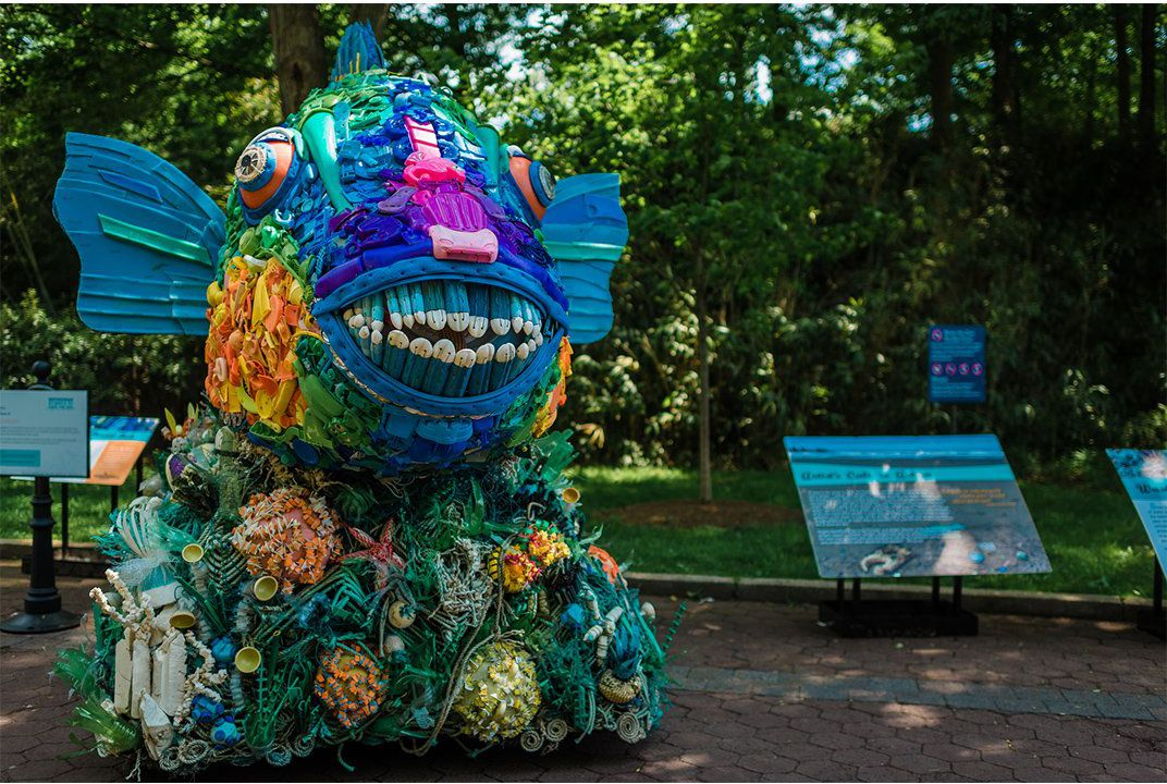 There's a bunch of animals at the zoo made out of ocean garbage
