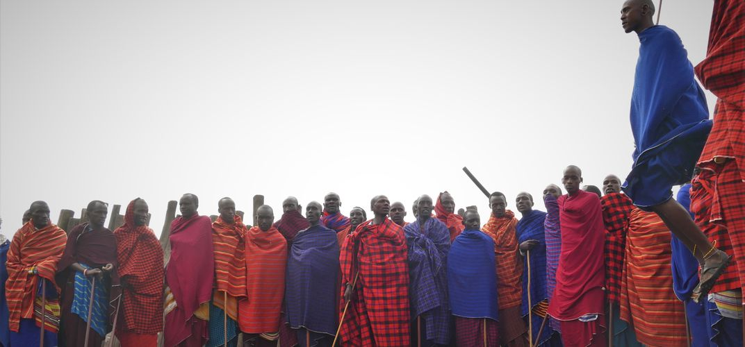 Exuberant Maasai in traditional garments.  Credit: Smithsonian Journeys Expert Grant Nel