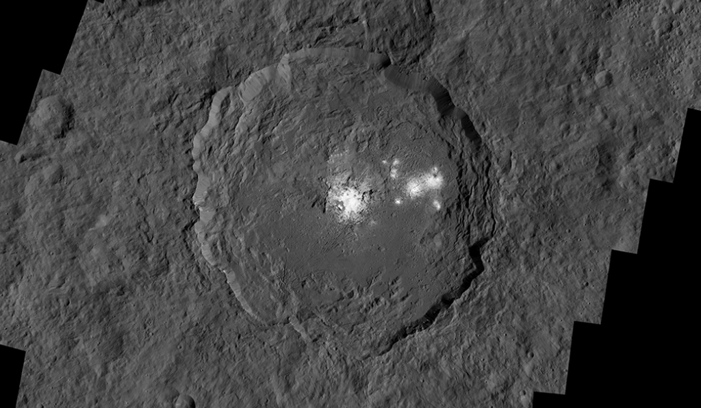 Occator Crater holds the brightest spots on Ceres. The spots are ice from liquid brine that flowed to Ceres' surface through ice volcanoes, proof of the dwarf planet's geological activity.