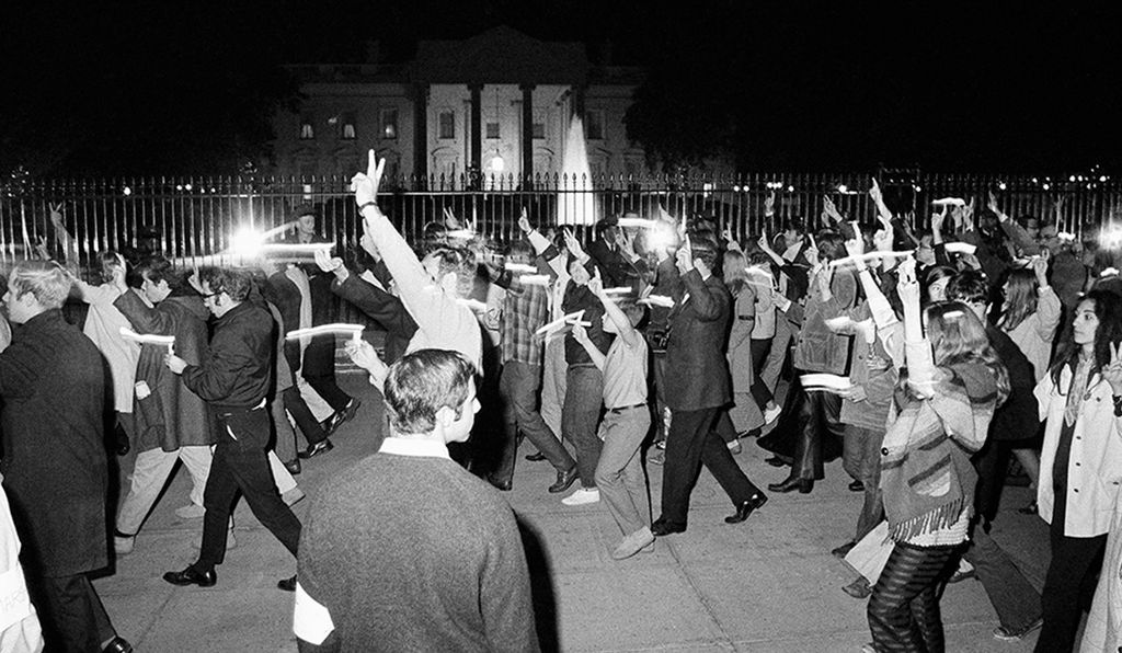 Peace marchers, carrying candles, pass the White House during the hour-long procession which ended the Vietnam Moratorium Day activities in Washington at night on Oct. 15, 1969.