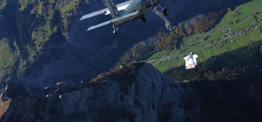 Caption: French Daredevils Leap From Mountain to Airplane