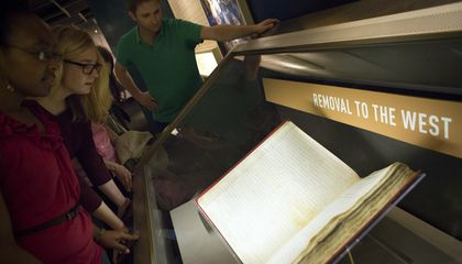 Visitors to the National Archives in Washington, D.C., viewing the Removal Act of 1830. Photo for the National Archives by Jessica Deibert