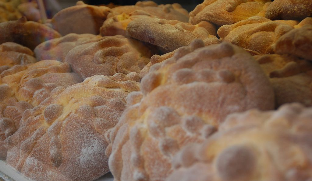 Loaves of pan de muertos sit in a shop window in Mexico City.