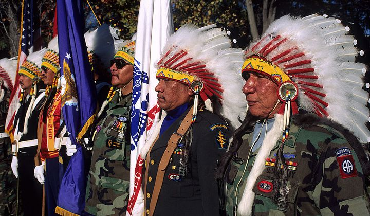 Native American veterans of the Vietnam War stand in honor as part of the color guard at the Vietnam Veterans War Memorial. November 11, 1990, Washington, D.C.  (Photo by Mark Reinstein/Corbis via Getty Images)