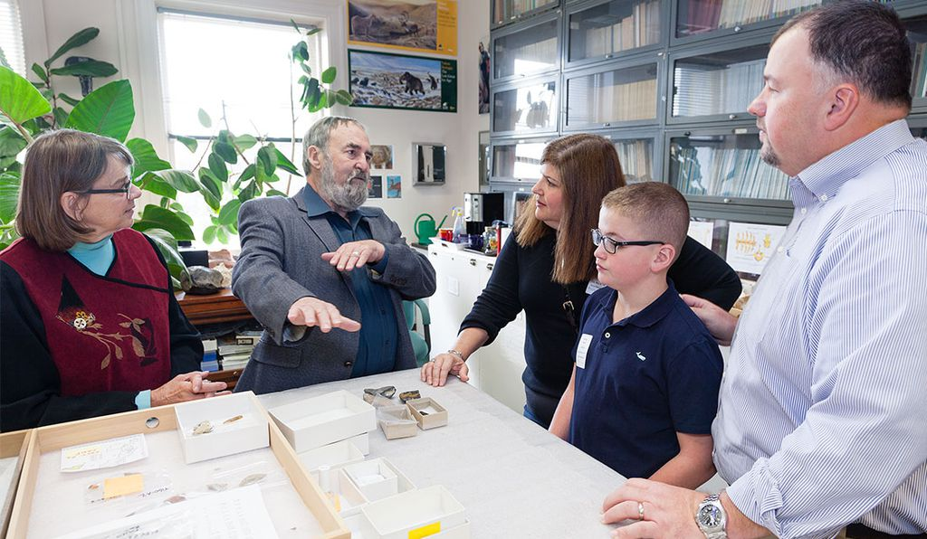 Pegi Jodry (left) and Dennis Stanford (second from left), archaeology experts at the Natural History Museum, explained to Noah and his family how the tool was once used.