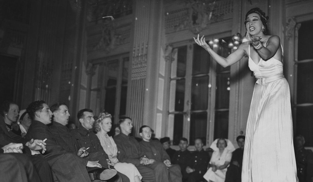 Josephine Baker performs for British troops on leave in Paris (May 1, 1940). (Hulton-Deutsch Collection/Corbis)