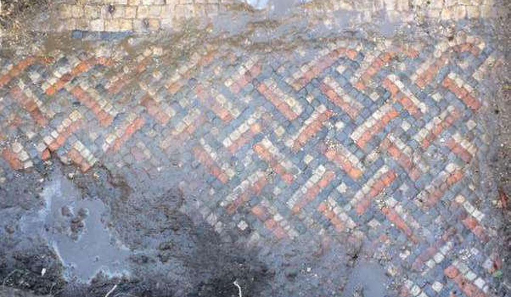 The mosaic floor uncovered by electricians