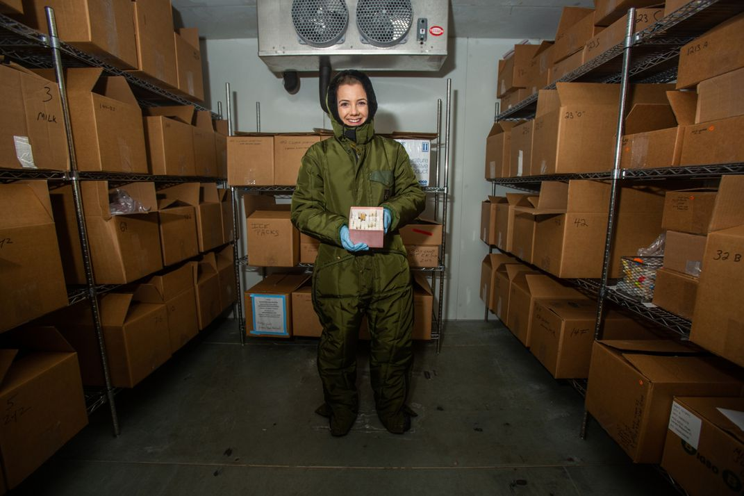 Jenna Pastel, research assistant for the Smithsonian's National Zoo's nutrition laboratory, stands inside a freezer stocked with samples of exotic animal milks. The freezer holds the largest animal milk repository in the world.