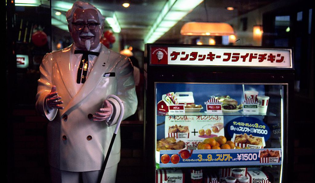 A Kentucky Fried Chicken stall with an effigy of Colonel Sanders the founder of the company.