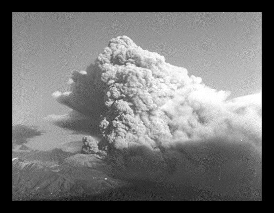 A black and white archival photo of a volcanic eruption.