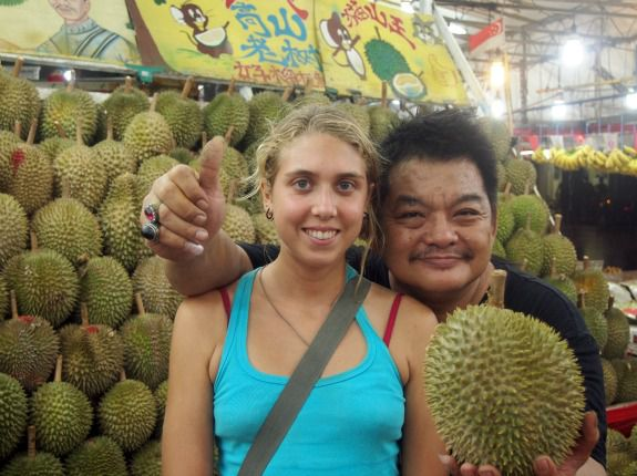 Lindsay Gasik poses with a durian vendor in Singapore.