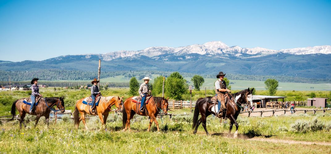 Horseback riding during the ranch stay