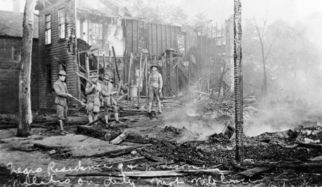 A house left smoldering after racial unrest broke out in Springfield, Illinois, in 1908