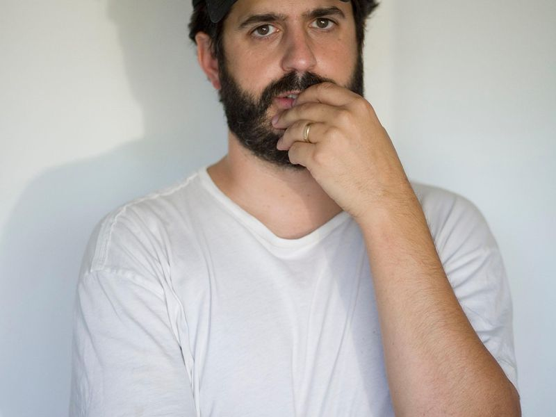 Photograph of Alec Soth taken in his studio