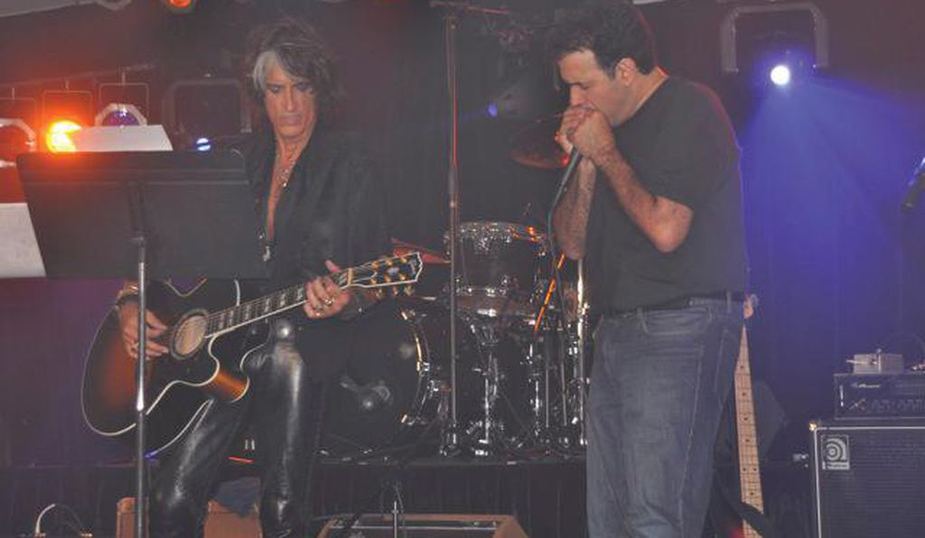 Tanzi, who has recorded with Aerosmith, accompanies the band's lead guitarist Joe Perry at a 2012 charity concert.