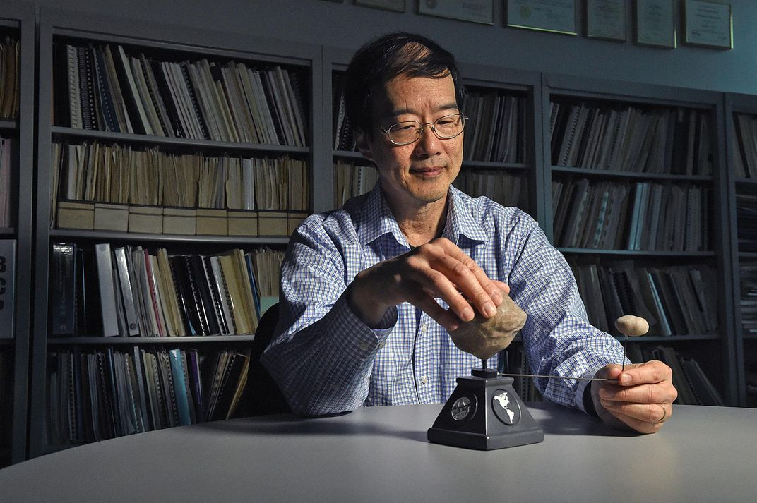 Andy Cheng with model asteroid system