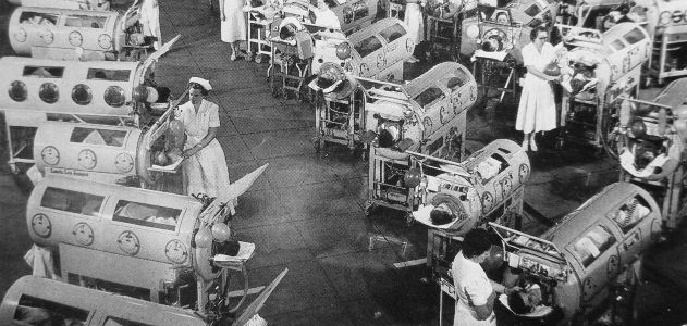 Polio patients in iron lungs in 1952