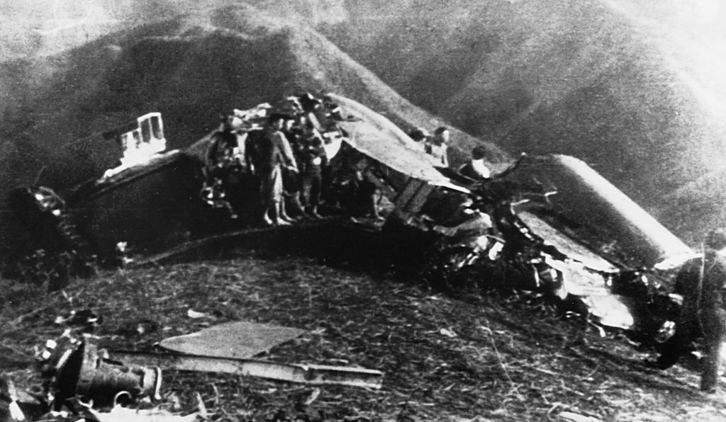 Wreckage of Major General Doolittle's plane somewhere in China after the raid on Tokyo. Doolittle is seated on wreckage to the right.