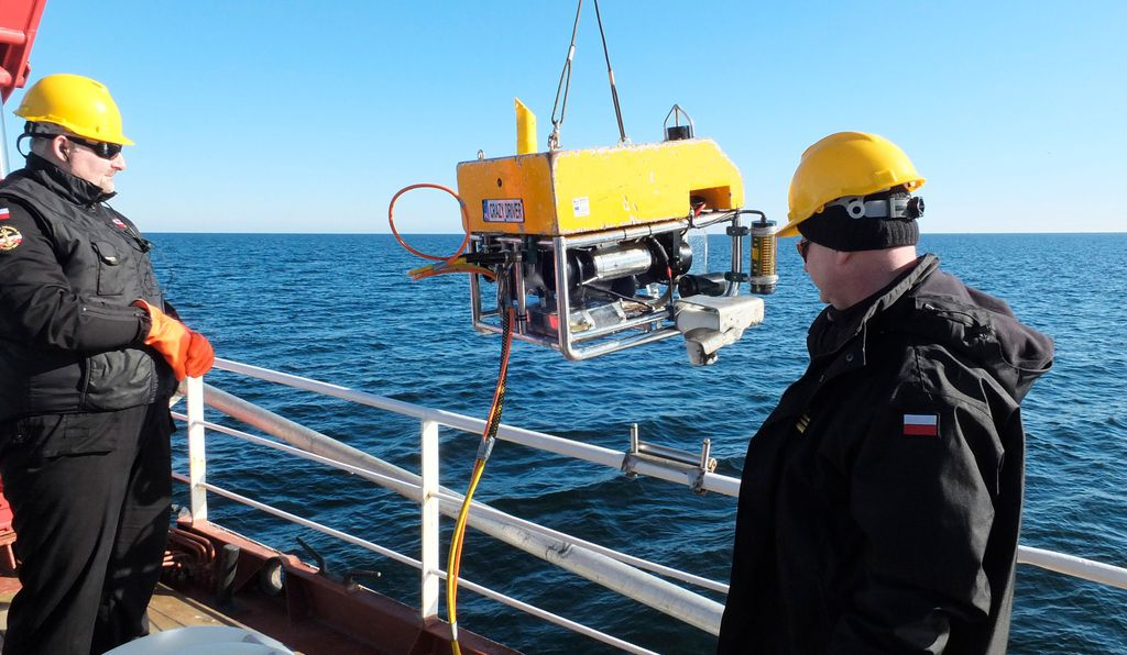 Scientists at the Polish Academy of Sciences's Institute of Oceanography use a remotely-operated submersible to take samples of water and sediment around chemical munitions at the bottom of the Baltic.