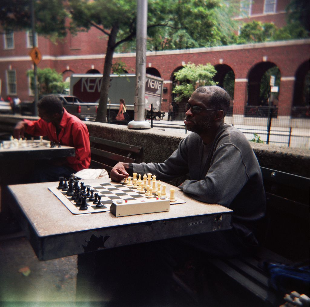 Man playing chess in Washington Square Park, NYC