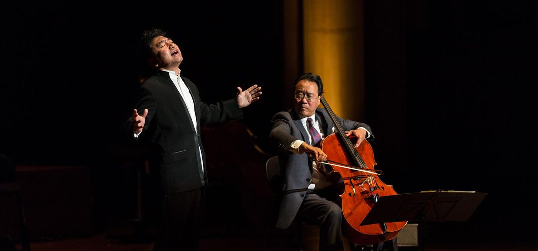 Yo-Yo Ma with Silk Road Ensemble musician. Credit: Khalid Al Busaidi and The Silk Road Ensemble