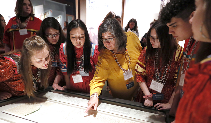 Members of the Cherokee Youth National Choir taking part in the installation of the Treaty of New Echota at the National Museum of the American Indian in Washington, D.C. (Paul Morigi/AP Images for the Smithsonian)